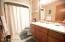 Full Bath with newer Counter tops and custom cabinetry