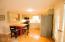 The kitchen also has hardwood floors.