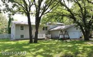 Set back from the road sits very nice spacious home with 4BR, 3BA!