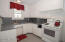 Very efficient kitchen with fresh updates and ample storage