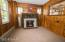 Charming den with fireplace and stone surround and pass thru to the dining room adds the character of this long time family home.