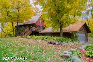 2.77 acres 30 x 50 shed, 1/14 access to Lobster Lake and on the shores of an pretty pond. (Heart Lake to the locals)