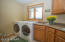 Main floor laundry with utility sink and lots of storage!