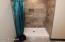 Pristinely done tiled shower off of Master Bedroom
