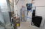 Utility room in garage, water softener is already in and all ready to go too!