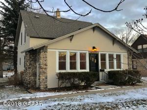 6 car garage!! Fireplace! Updated, neat and clean as can be! This home offers 3 bedrooms, living room and den with fireplace, tree lined streets and sidewalk! This is a lovely home!
