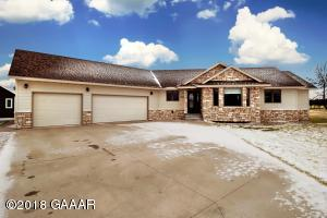 Welcome home! Main floor laundry, big yard, great location! Irrigation system for green green grass!