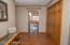 Welcoming spacious foyer and closet with six panel doors.