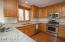 Recently updated, stainless appliances and custom cabinets, under counter lighting.