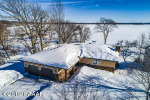 Beautiful level to the lake lot on pristine Maple Lake. Original owner, pride of ownership shines through here!