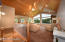 Vaulted knotty pine ceiling with Open Floor Plan