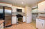 Crisp white cabinetry with stainless appliances