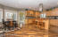 Kitchen, sunroom entrance, and combined dining area