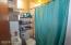 Main floor bathroom off of main floor bedroom and laundry room