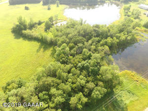 3.74 acres - build here! Enjoy wildlife and the convenient location!