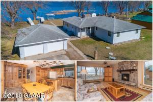 Move in ready Year round lake home with 100FT of level lake shore!