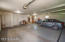 Huge garage! almost 1500 square feet of garage!! Lakeside stall has its own door, heated for shop area and access to the patio and lakeside!