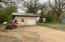.28 Acre lot water and sewer located just outside of unfinished wall. Start finishing your man cave or tiny home
