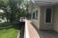 Full length mtnce-free deck, w/ glass railing from mstr bdrm wing