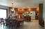 Large, open kitchen dining perfect for entertaining, large sliding glass door to lake side deck