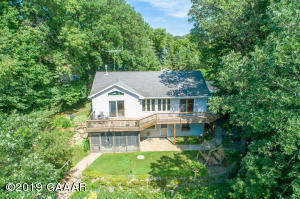 Find yourself at home in this private hideaway. 5+/- acres, 630 +/- feet of frontage. Park like yard and level at the lake lot!