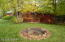 Spacious yard with fire pit and Extra Parking Pad that could be converted into an additional garage.