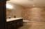 Main Floor Bathroom with Tile Shower.