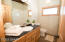 Main 3/4 bath with subway tiled walk in shower