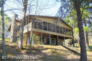 Lake Beltrami Home which includes a spacious 3 season room and large Shop/Garage