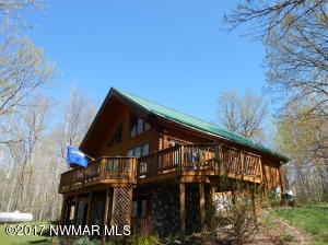 Lovely log home on 28 acres in country.