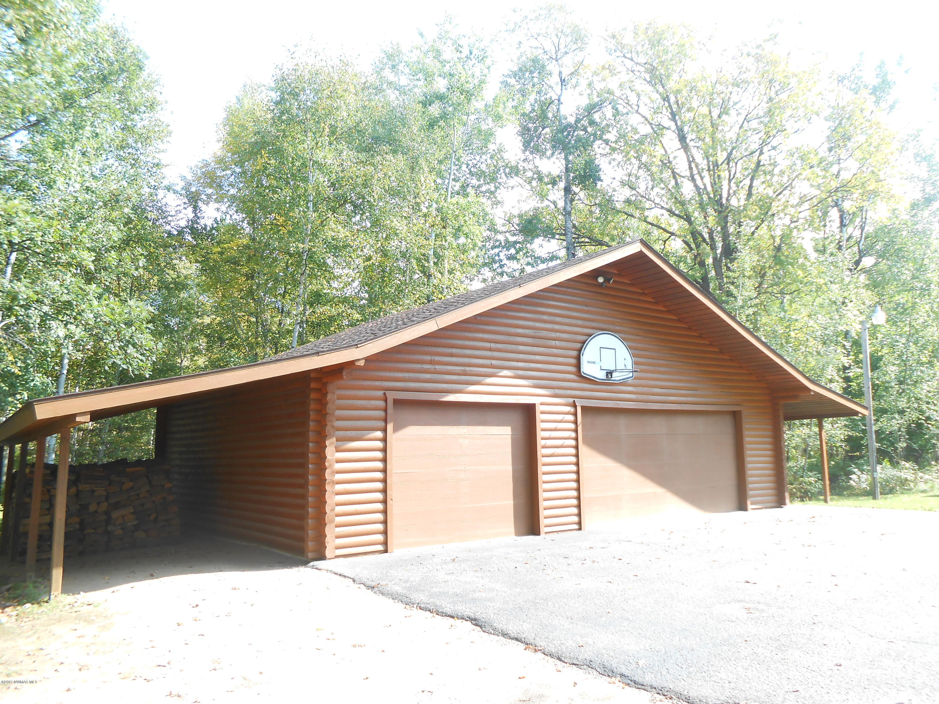Lean-to on both sides of garage