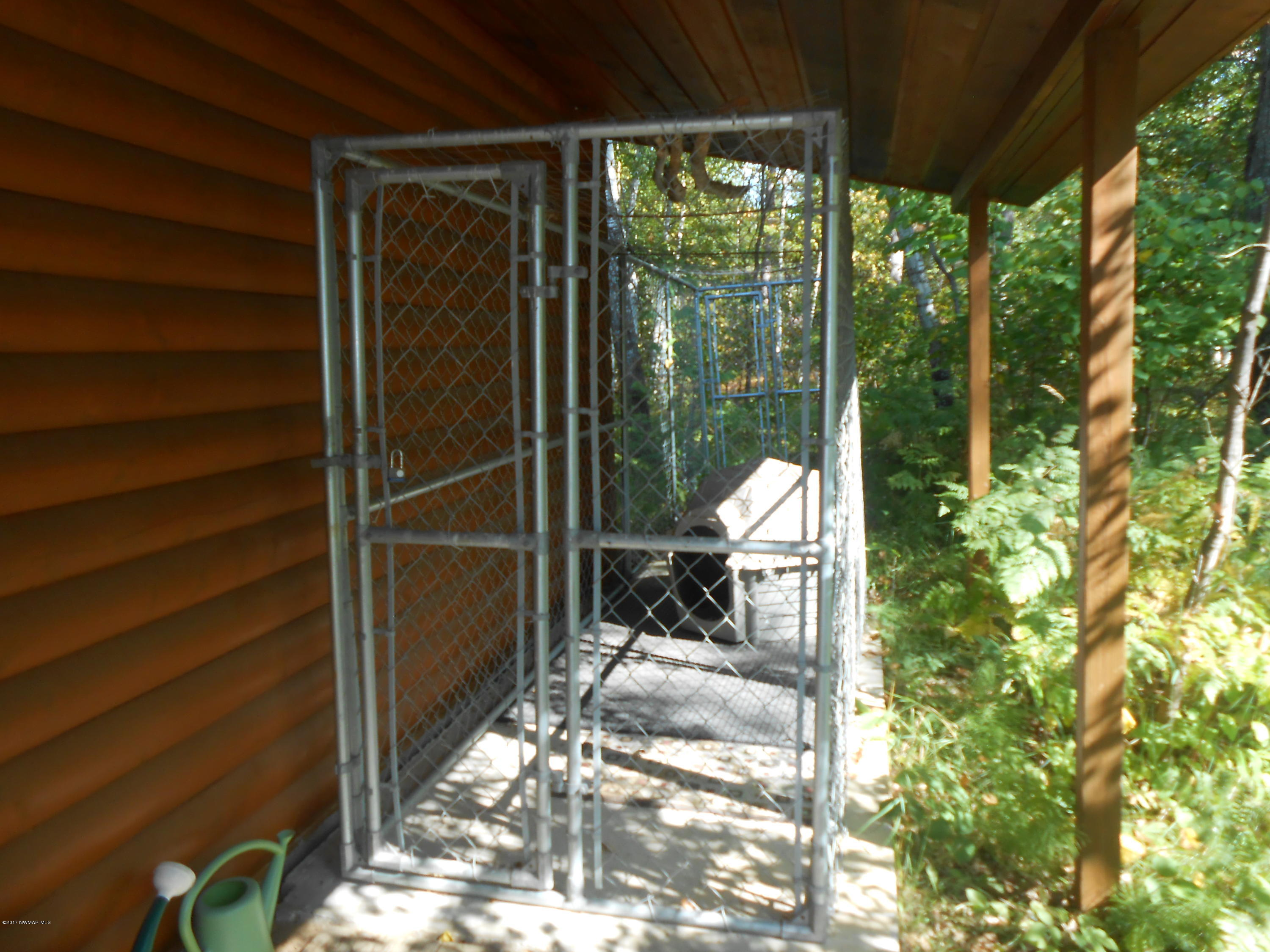 Dog kennel stays with the home