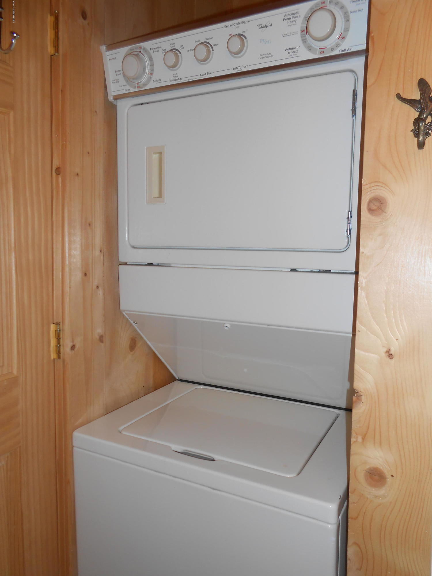 Stackable washer and dryer in bathroom