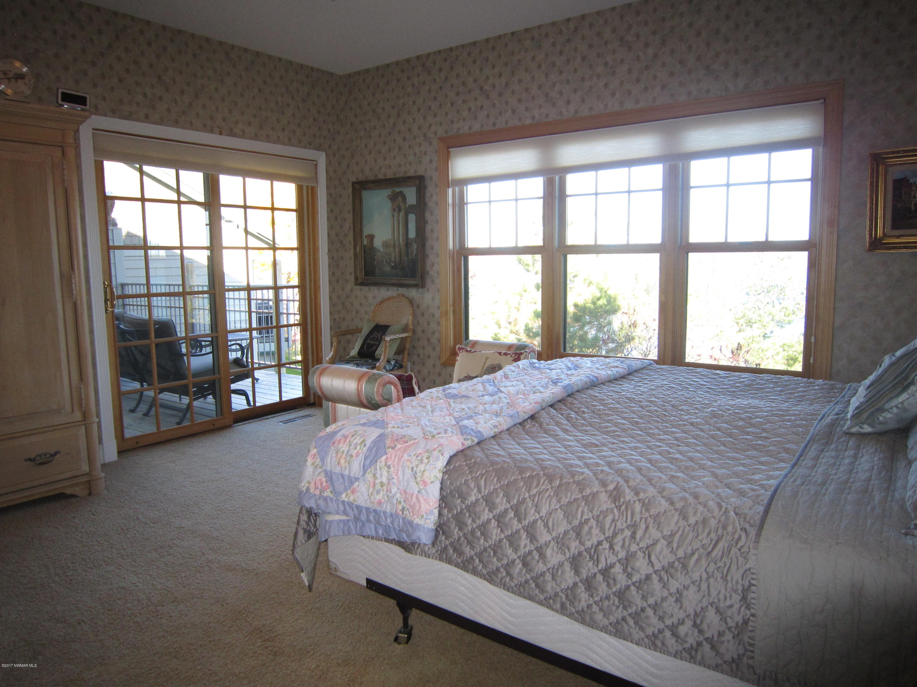 Master Suite opens to lake side deck