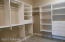 Master upgraded walk in closet With porcelain flooring