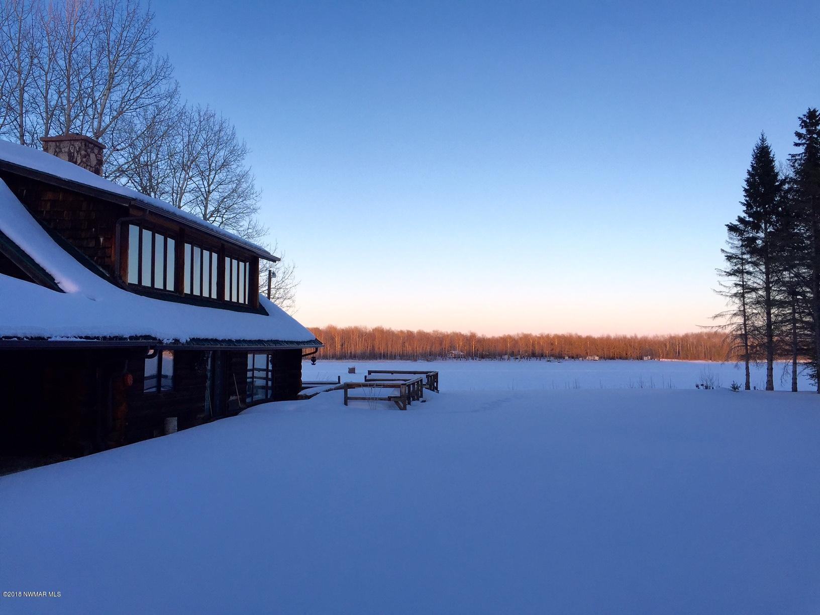 Staked snowmobile trail runs right down the river leading to miles and miles of groomed trails!