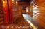 Hallway floor has door that opens to 10x10 basement