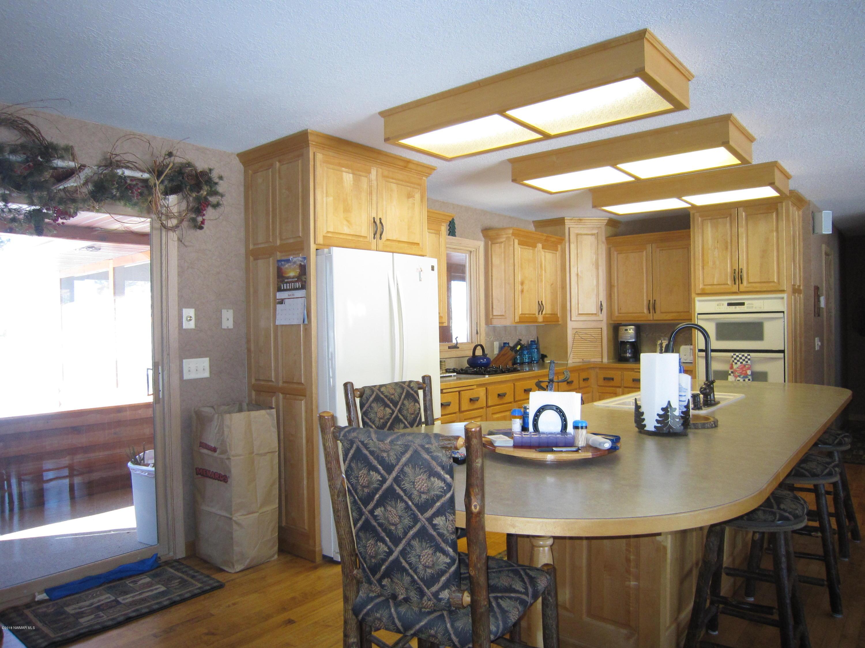 Kitchen, patio door to screened in porch