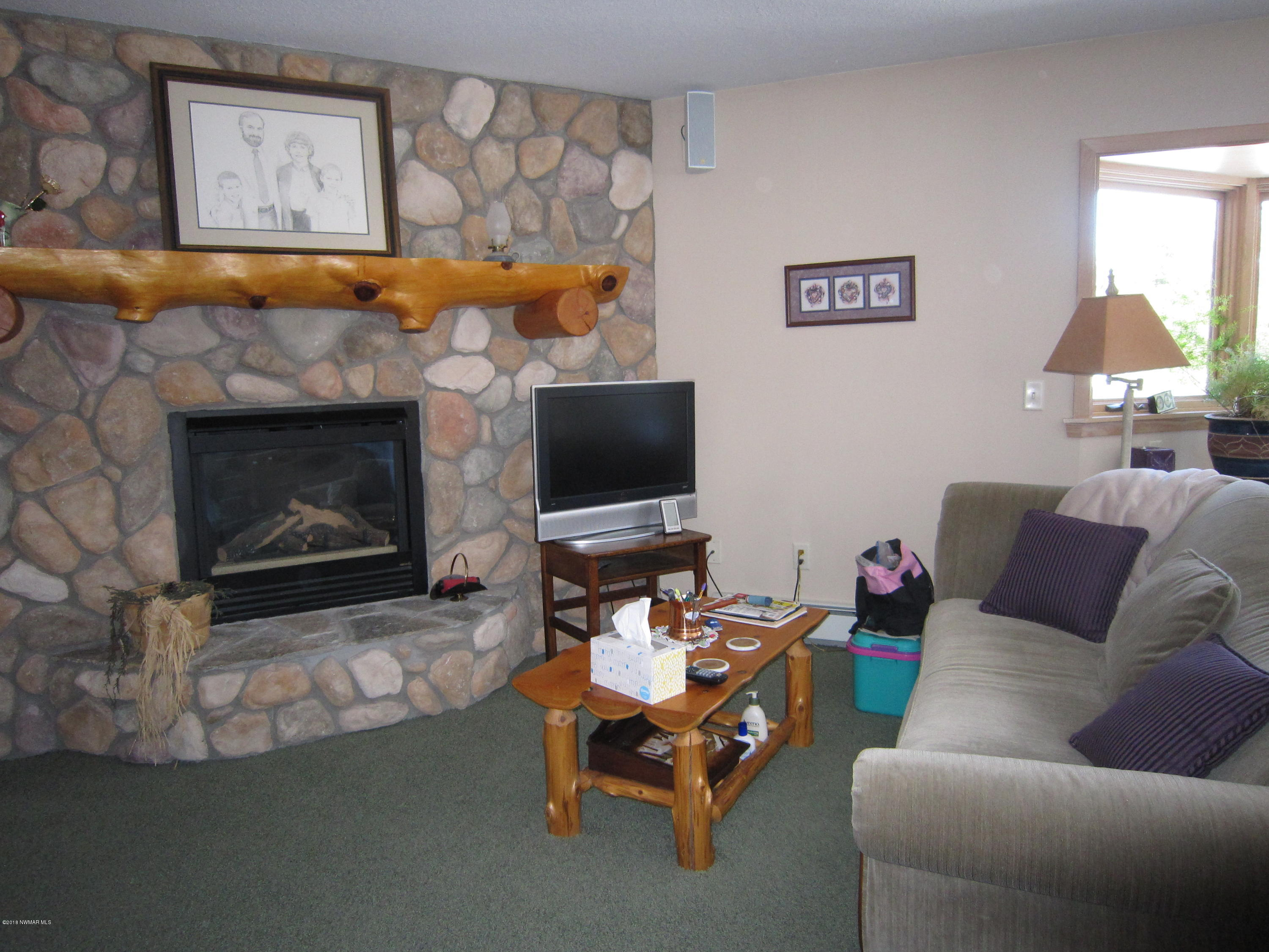 Mstr Suite with sitting area & gas fireplace