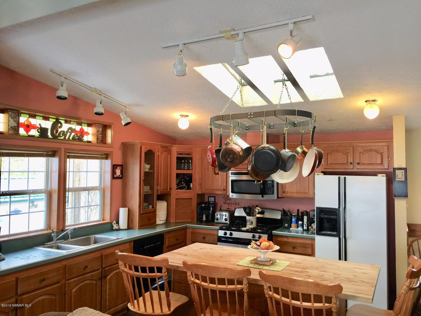 skylights in kitchen add lots of natural light!