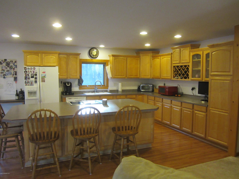 Nice lighting, pantry, wine rack