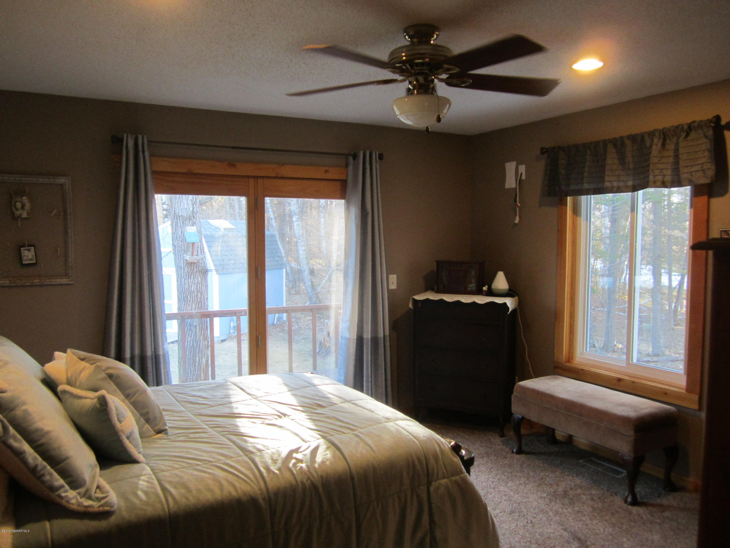 Master bedroom w/lots of light and walk in closet.