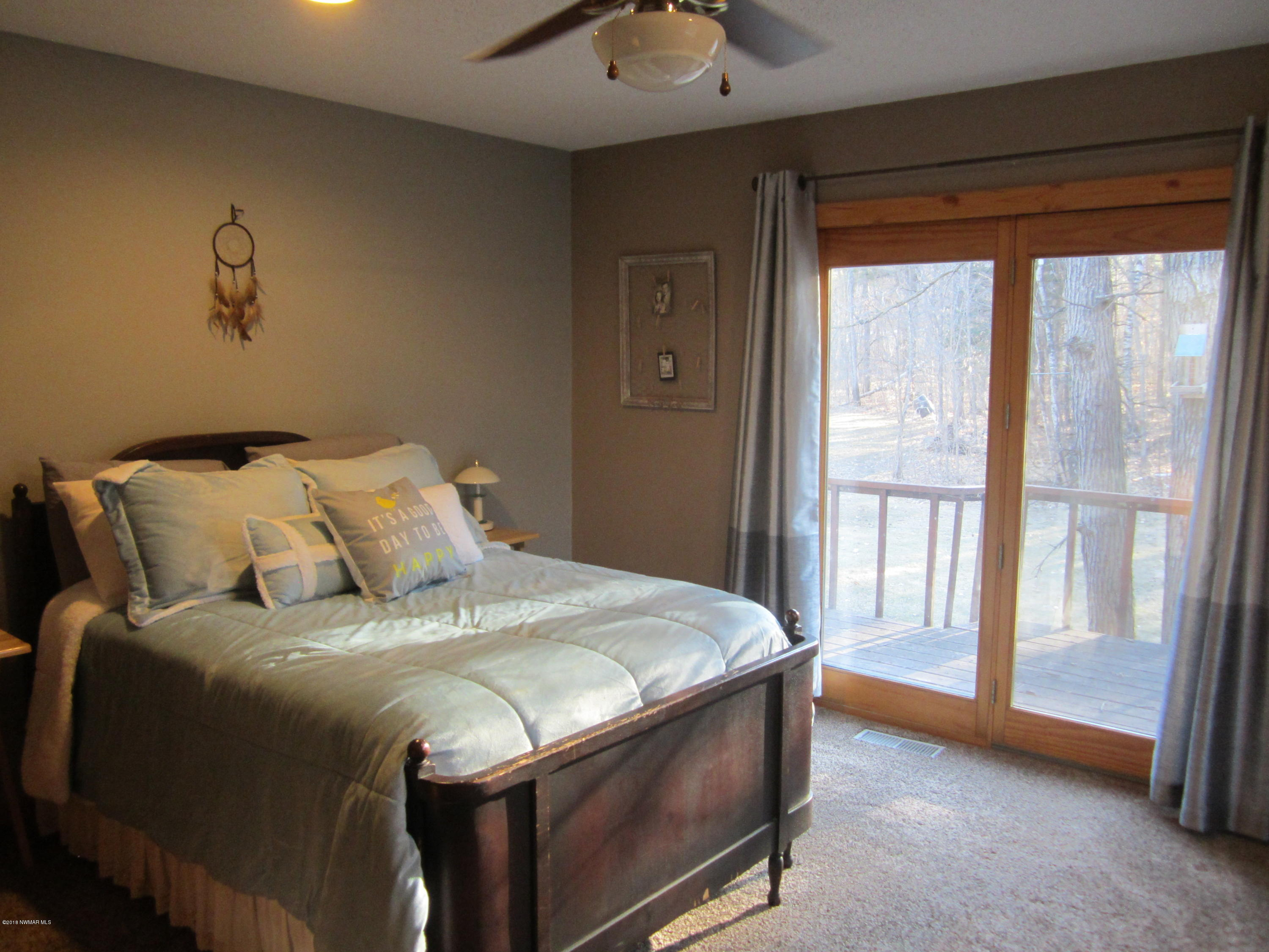 Master bedroom which goes out to wrap around deck.