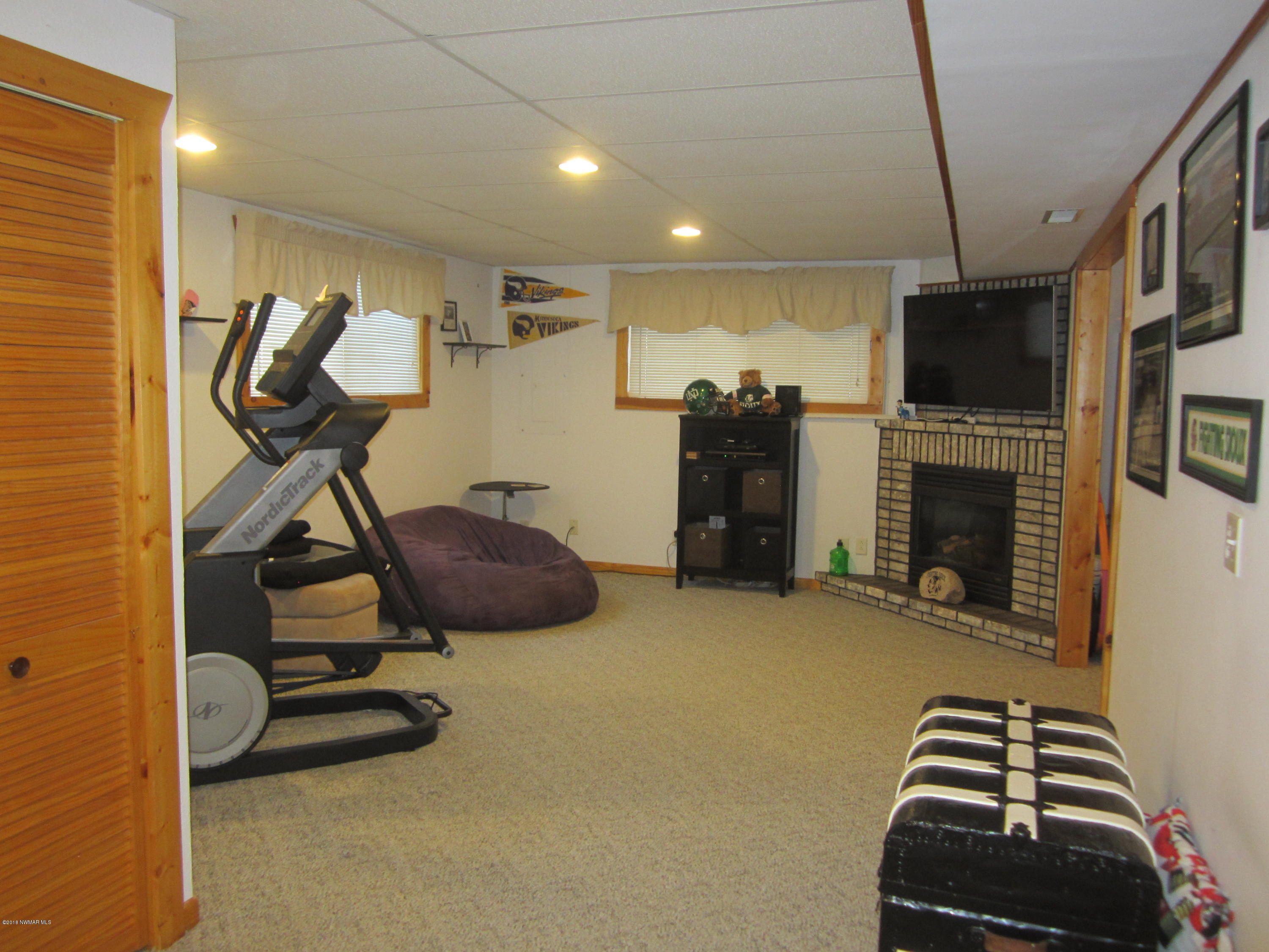 Basement family room with gas fireplace