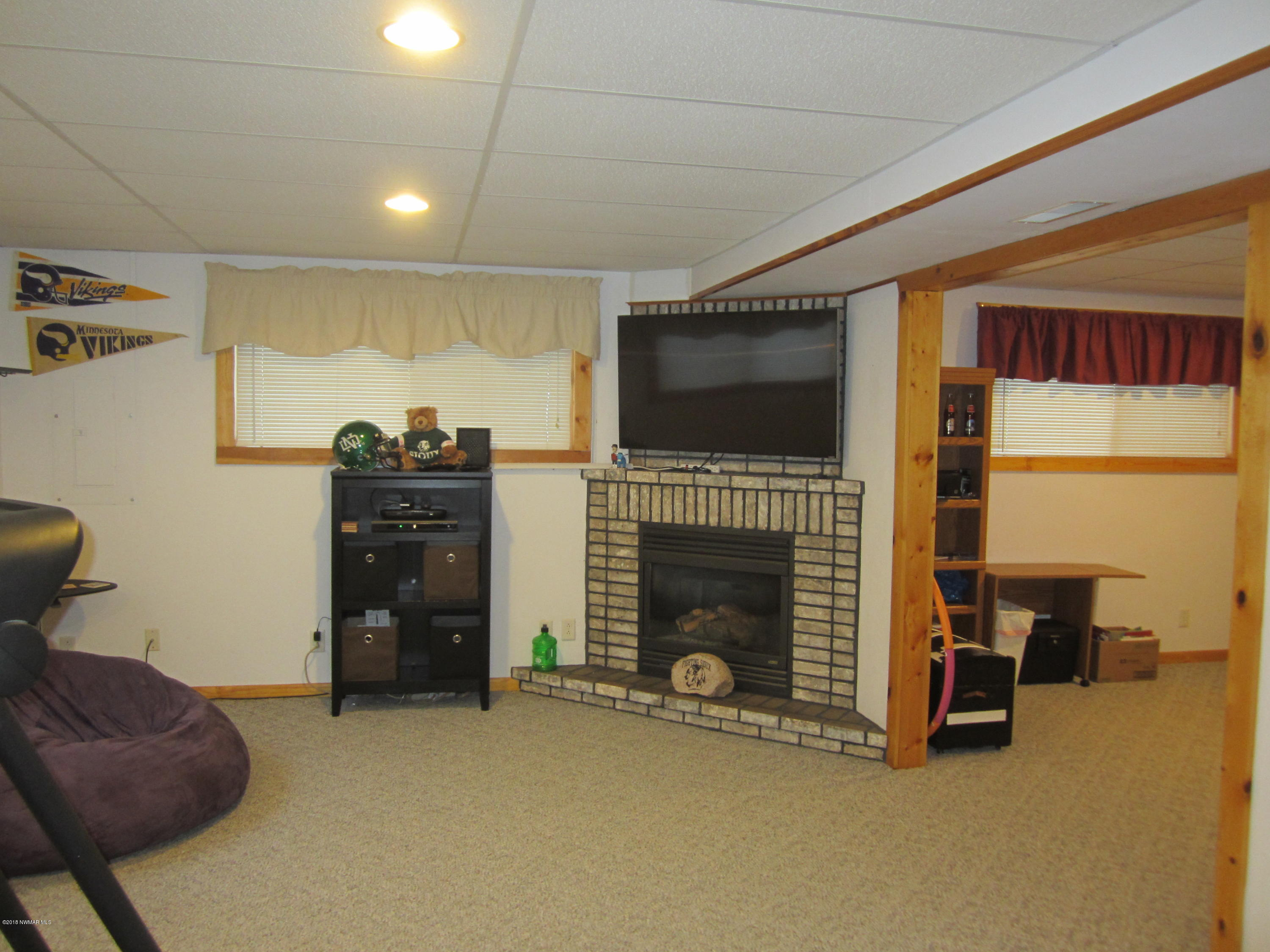 Main portion of family room leads to second portion