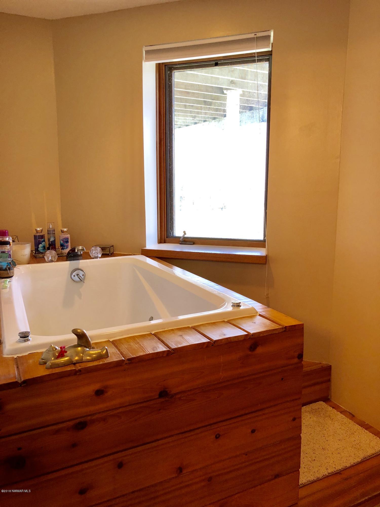 Master bedroom whirlpool tub with views of Lake Bemidji