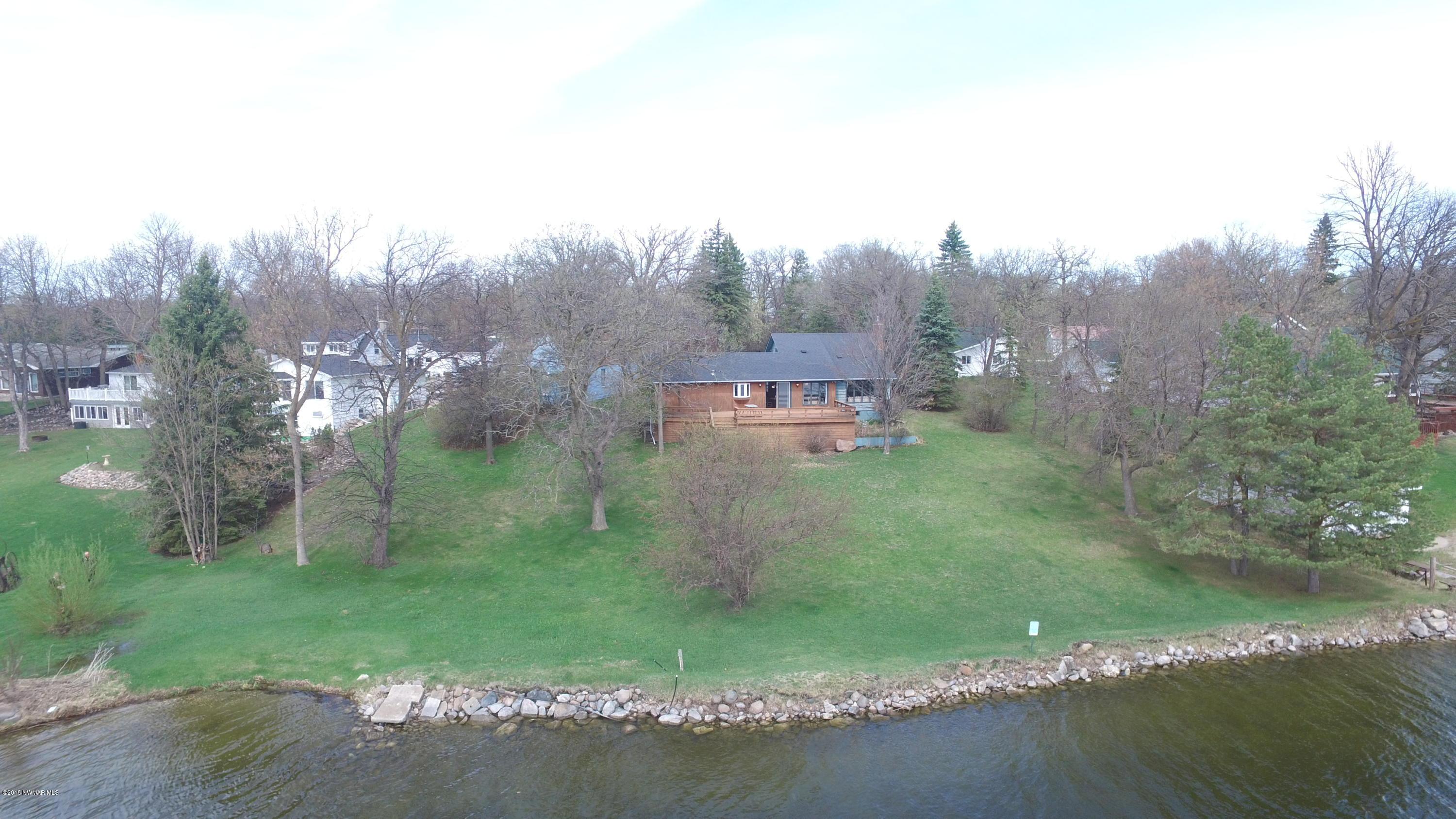 Stunning property set on 212 feet of Maple Lake shoreline. Enjoy hard bottom lakeshore and large boulder retaining wall, there is little left to do with this property but enjoy the lake!