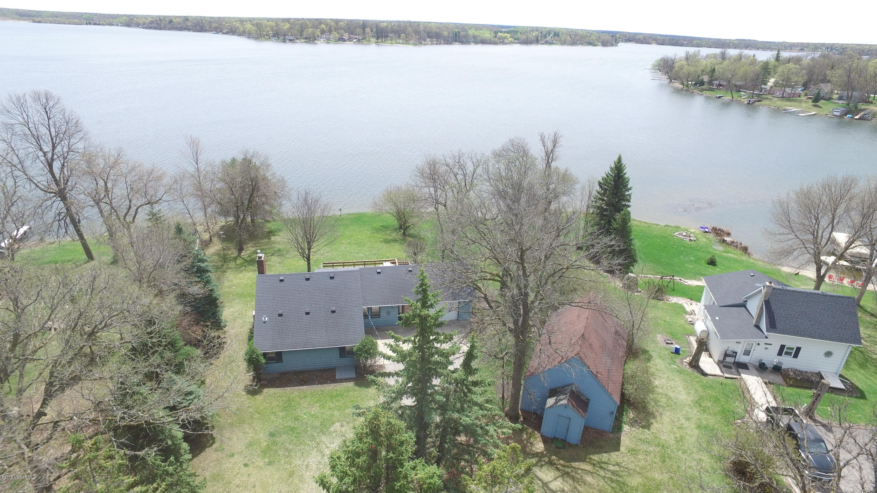 Maple Lake home set on .86 acres including home and storage building.
