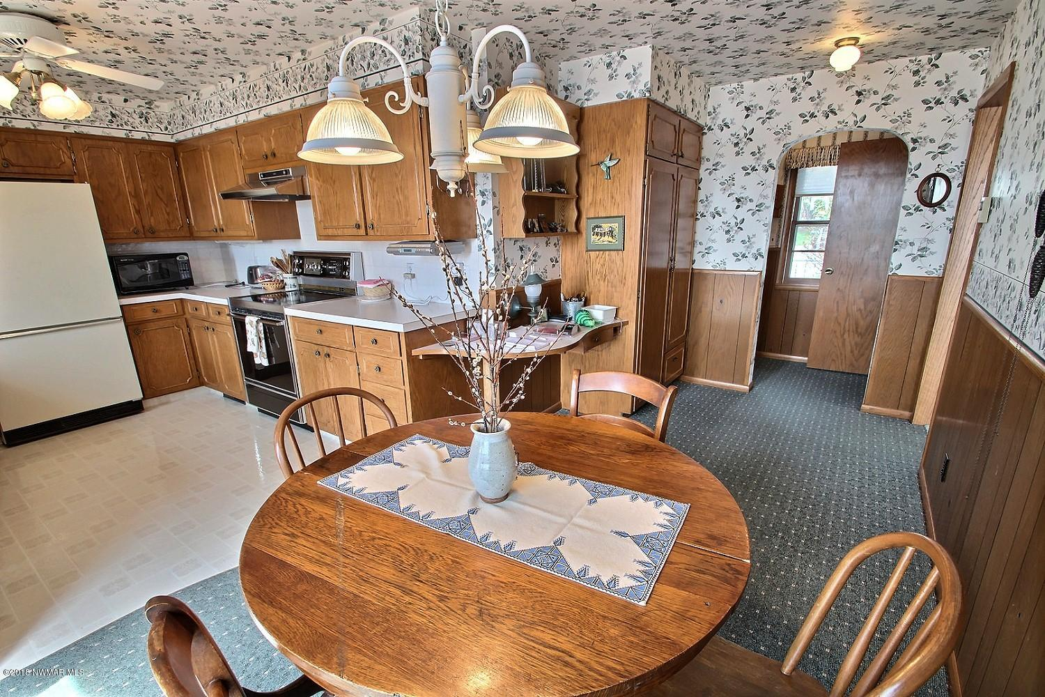 Another view of the dining room leading into the kitchen. This home is move in ready and waiting for your personal touch, enjoy lake living today!