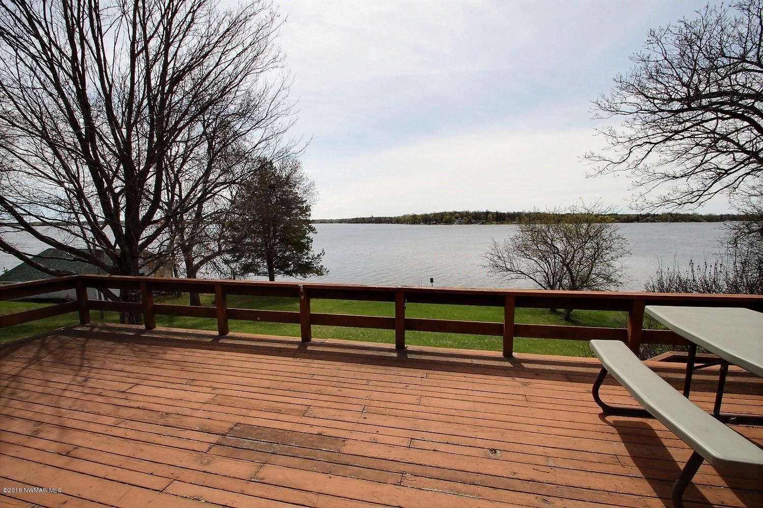 Enjoy a spacious deck overlooking the gorgeous level yard perfect for yard games. Fire up the grill and entertain with views of Maple Lake!